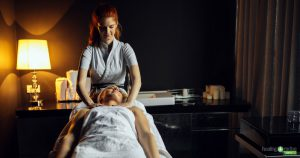 Massage therapist and client both using good self-care practices