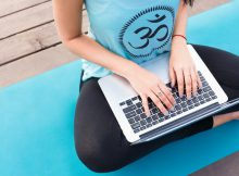 Yoga studio owner works on holiday emails to be sent to clients